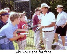 Chi Chi signs for fans